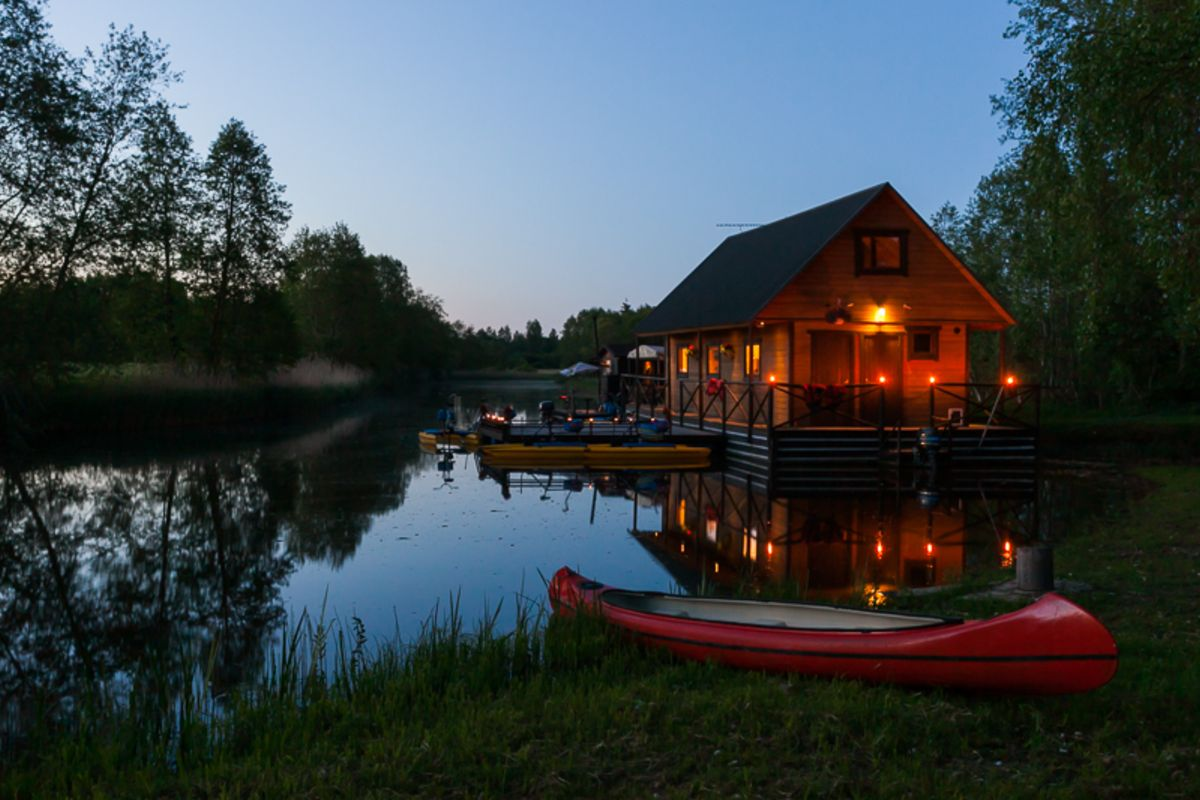 A small raft house at night